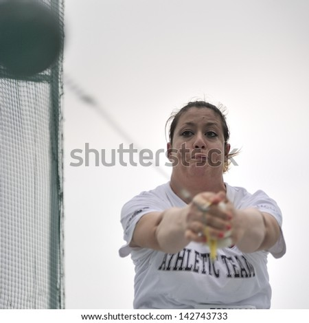 TURIN - JUNE 8:Elisa Magni from Italy performs Hammer Throw at XIX Turin International Track and Field meeting in Turin, Italy on 8th june 2013, in Turin, Italy. - stock photo