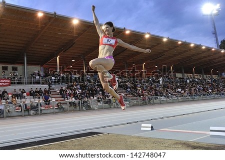 TURIN - JUNE 8: Pidluzhnaya Yuliya from Russia performs long jump woman at XIX Turin International Track and Field meeting, Italy on 8th june 2013, in Turin, Italy. - stock photo