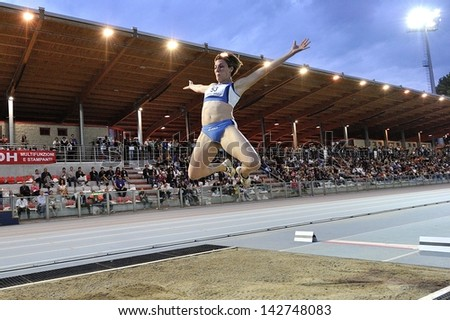 TURIN - JUNE 8:Vincenzino Tania from Italy performs long jump woman at XIX Turin International Track and Field meeting, Italy on 8th june 2013, in Turin, Italy. - stock photo