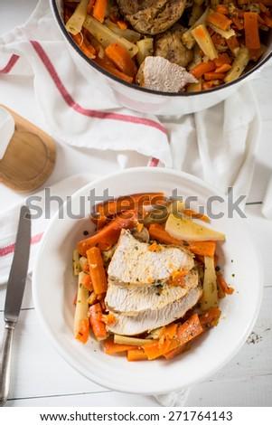 turkey breast with carrots - stock photo