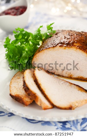 Turkey breast with cranberry sauce for Christmas dinner - stock photo