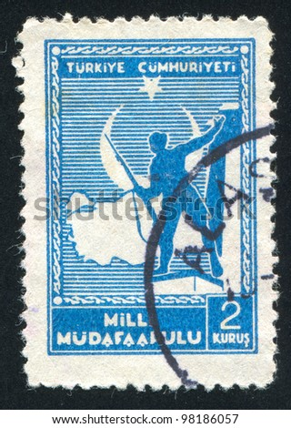 TURKEY- CIRCA 1941: A stamp printed by Turkey, shows Soldier and Map of Turkey, circa 1941 - stock photo