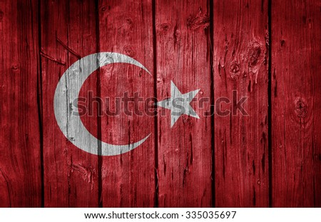 Turkey flag painted on old wooden background - stock photo
