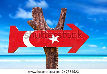 Turkey Flag wooden sign with beach background - stock photo