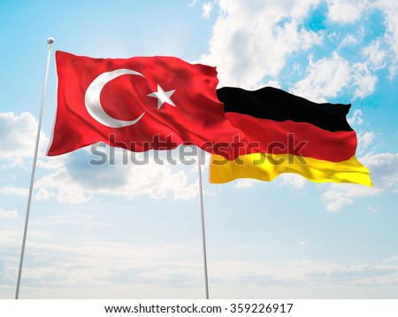 Turkey & Germany Flags are waving in the spring of the blue sky. - stock photo