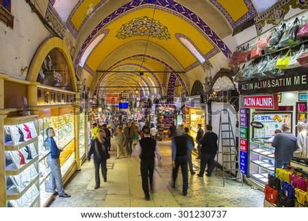 TURKEY, ISTANBUL - MAY 12,2015: Buyers of t tourists on the Grandee Bazare in Istanbul. Grand-Bazar - one of the largest covered markets in the world - stock photo