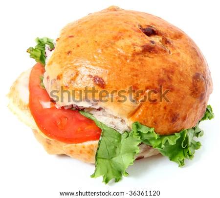 Turkey, mayo, lettuce, tomato on cranberry roll. - stock photo