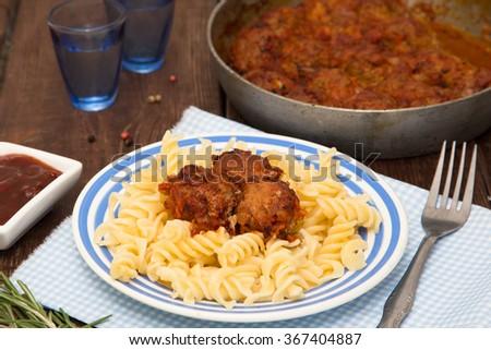 Turkey meatballs  in tomato sauce with pasta - stock photo