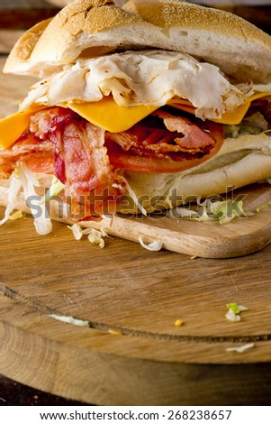 Turkey Sandwich with Cheddar Cheese & Bacon - stock photo