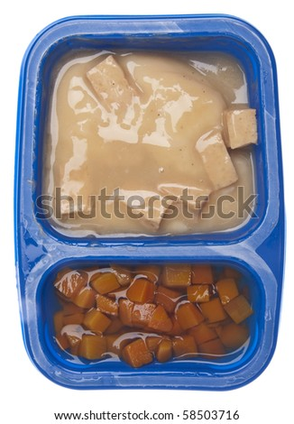 Turkey with Gravy and Carrots TV Dinner in a Child Sized Portion Isolated on White with a Clipping Path. - stock photo