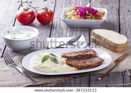 Turkish and arabic traditional meal potato mash and roast meat loaf , rosto kofte - stock photo