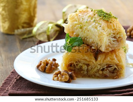 Turkish arabic dessert - baklava with honey and walnut nuts - stock photo