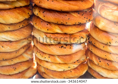 Turkish bagel bread called Simit in Istanbul, Turkey, selective focus - stock photo
