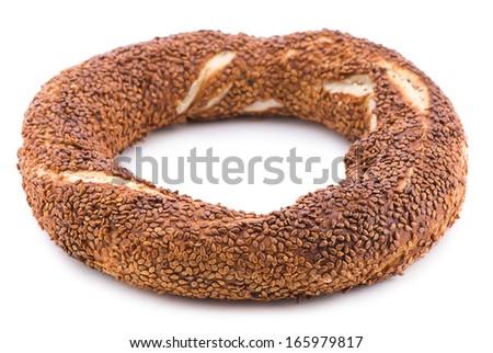 Turkish bagel called simit isolated on white background    - stock photo