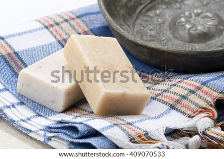 Turkish bath towel known as pestemal towel and copper bowl. - stock photo