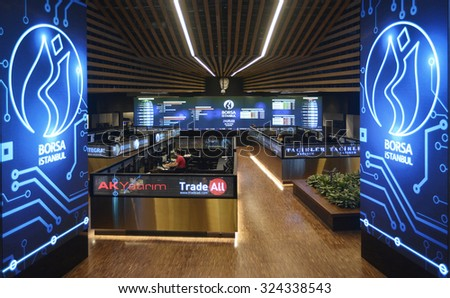 Turkish brokers sit at Istanbul Stock Exchange in Istanbul, 26 August 2015, Turkey, Istanbul. Istanbul Stock Exchange has been renewed in 2015. - stock photo