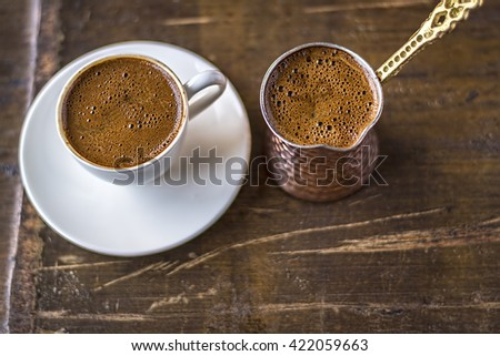 Turkish coffee and coffee pot on wooden background. Top View - stock photo