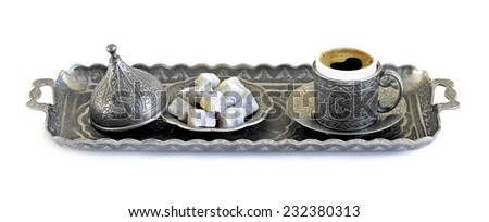 Turkish coffee and turkish delight with old traditional embossed  metal cup and tray - stock photo