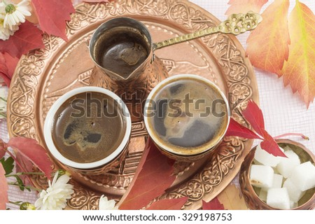 Turkish coffee with flowers and sugar served on copper plate. - stock photo