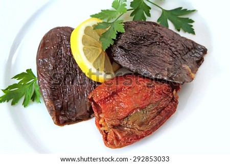 Turkish cuisine - DOLMA - rice stuffed sundried red pepper and eggplant - stock photo