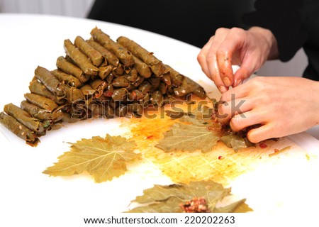 Turkish cuisine. Homemade Sarma - Rice wrapped in grape leaves - stock photo