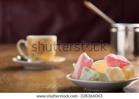 Turkish delight and turkish coffee on wooden table - stock photo