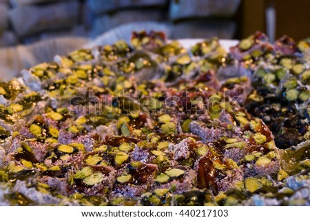 Turkish delight dessert. Soft candy, nougat with pistachio in coconut coating. Close up, selective focus, shallow DOF - stock photo