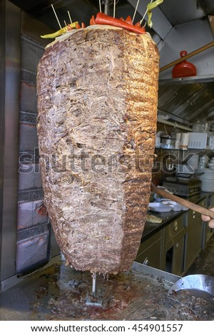 Turkish dish made of meat cooked on a vertical spit and sliced off to order. Alternative names include kebap, donair, doner or donner. - stock photo