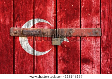 Turkish flag on the background of old locked doors - stock photo