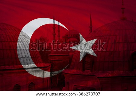 Turkish flag with view of Blue mosque in Istanbul seen in background - stock photo