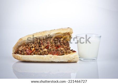 Turkish Kokorec - lamb intestine food sandwich and ayran with white background  - stock photo