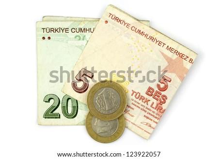 Turkish lira coins and folded notes isolated on white background. - stock photo