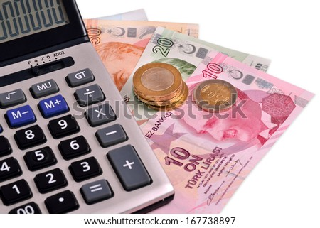 Turkish money and calculating machine on white background - stock photo