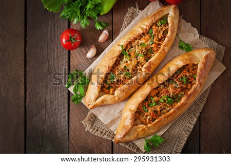 Turkish pide traditional food with beef and vegetables - stock photo