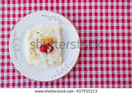 Turkish ramadan dessert gullac on a rustic tablecloth top view - stock photo