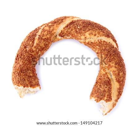 Turkish sesame bagel ( bitten ). - simit -  - stock photo