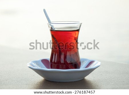 Turkish Tea in traditional glass. Traditional tea plate.  - stock photo