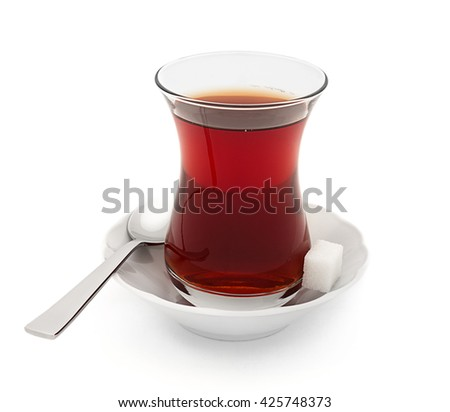 Turkish tea served in traditional glass isolated on white background    - stock photo