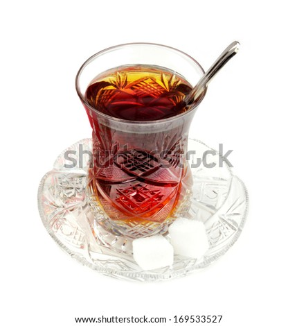 Turkish tea with traditional crystal glass isolated on white background. - stock photo