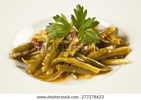 Turkish traditional Fresh Beans food on white plate - stock photo