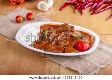 Turkish Traditional iskender kebap with yogurt - stock photo