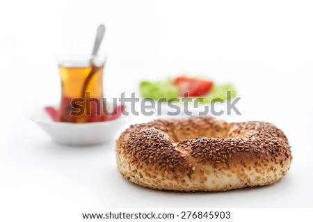 Turkish traditional sesame bagel ( Simit ) with Turkish Tea. And vegetables.   - stock photo