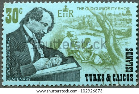 """TURKS AND CAICOS ISLANDS - CIRCA 1970 : A stamp printed in Turks and Caicos Islands shows writer Charles Dickens (1812-1870), English novelist and """"The Old Curiosity Shop"""" scene, circa 1970 - stock photo"""