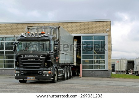 TURKU, FINLAND - APRIL 5, 2015: Clean Scania R560 Trailer truck drives out of truck wash. Regular washing helps to combat corrosion caused by road salts.  - stock photo