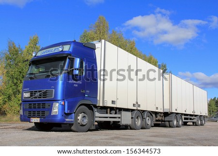 TURKU, FINLAND - SEPTEMBER 28: Volvo FH truck and full trailer on September 28, 2013 in Turku, Finland. The Volvo Group ranks as one of the world'??s most sustainable companies again in 2013. - stock photo