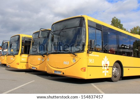 TURKU, FINLAND - SEPTEMBER 15: Yellow city buses on September 15, 2013 in Turku, Finland. On the World Car-Free Day 22 September, bus fares in Finnish cities are considerably reduced. - stock photo