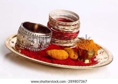 Turmeric and kumkum powder arrangements with bangles  - stock photo