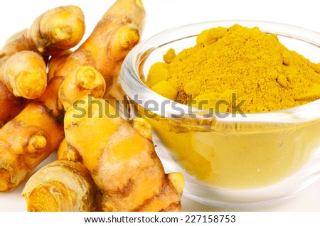 Turmeric (Curcuma longa L.) root and turmeric powder for alternative medicine ,spa products and food ingredient. - stock photo