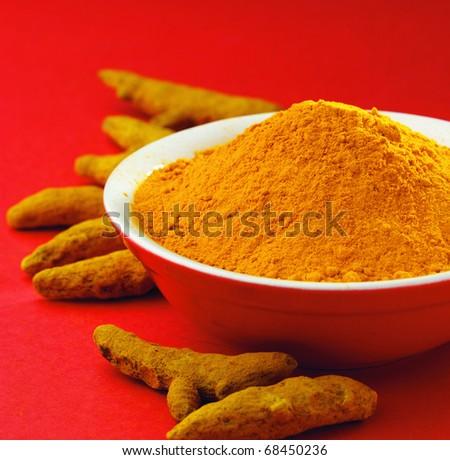 Turmeric powder and the turmeric sticks - stock photo