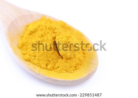 turmeric powder on isolated white - stock photo